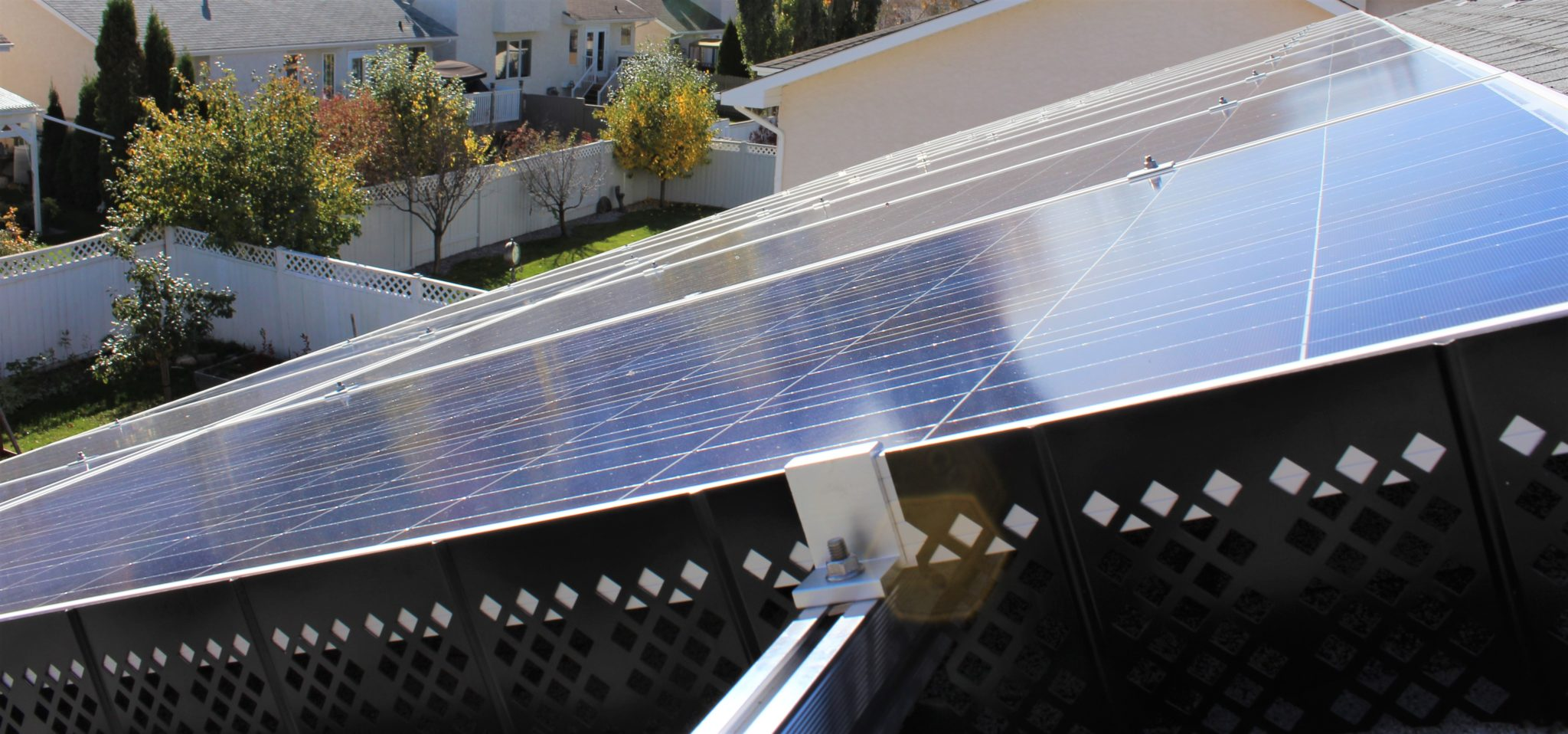 Roof-mounted solar panels with trim